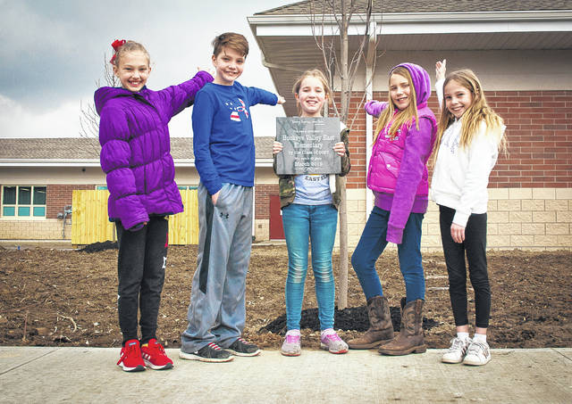 Students at Buckeye Valley East Elementary got the chance to step outside Thursday for a special tree dedication. Each grade level (pre-K through fourth) received a quote-inscribed plaque to place before a tree planted in front of the new elementary building. Proudly pointing to their tree are fourth-graders (left to right) Bridget Bolton, Jonah Meier, Chole Alexander, Sawyer Clark and Kayleigh Agin.