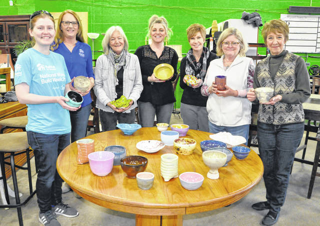 Pictured with some of the bowls that will be available on Tuesday, March 19, during Habitat for Humanity of Delaware & Union Counties' 17th annual Soups for Shelter event are members of the Soups for Shelter Committee.