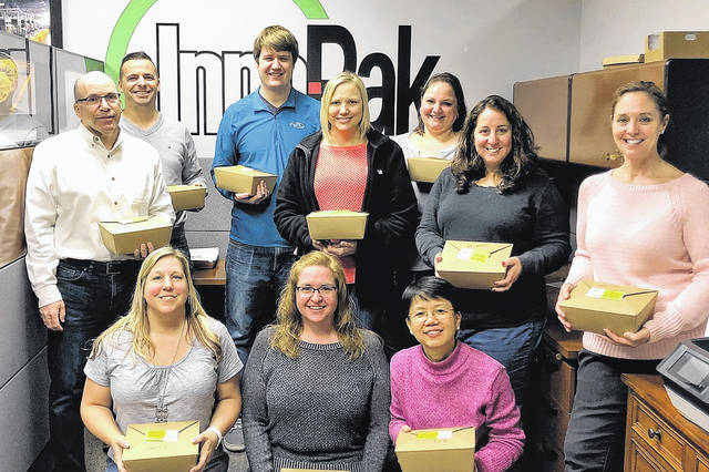 Gold sponsor Inno-Pak accepts delivery of boxed lunches for its staff during SourcePoint's 2018 fundraiser.