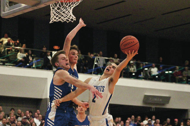 Olentangy Liberty's Henry Hinkle puts up a shot over Hilliard Davidson's Caleb Stimmel, front, and Jacob Drees during the second half of Saturday's Division I district final at the Columbus Convention Center.