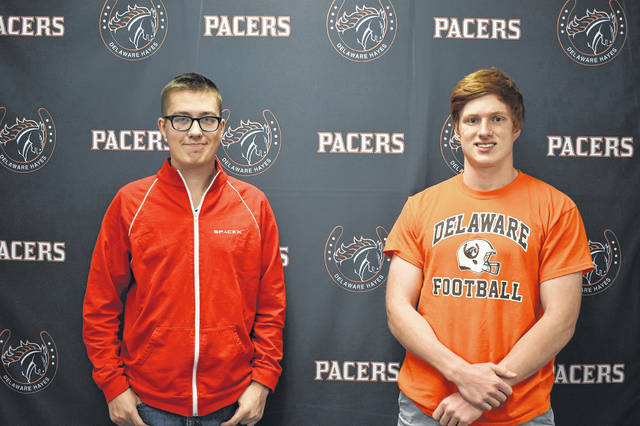 Hayes juniors Dominic Hupp, left, and Aaron Koehler, right, were recently recognized by the district for getting a perfect score, 36, on the ACT exam.