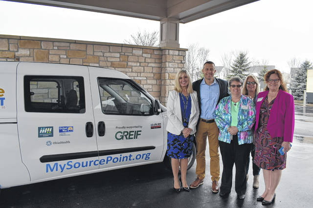 Matt Eichmann (second from the left), Greif's vice president of investor relations and corporate communications, presents the keys to a new Meals on Wheels delivery van to (left to right) SourcePoint Director of Client Services Fara Waugh, Nutrition Program Administrator Karen Pillion, Director of Operations Kimberly Clewell, and Development Officer Julie Zdanowicz. The van replaces a 2005 vehicle that had more than 100,000 miles on it and was plagued by several mechanical issues.