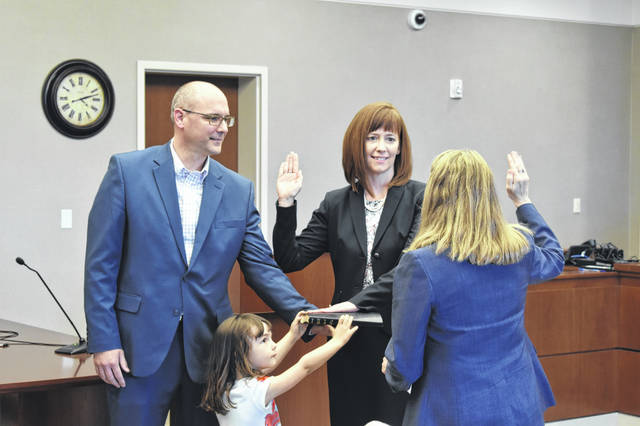 Melissa Schiffel is sworn in as Delaware County prosecutor by Carol O'Brien, who previously held the office before resigning in February to take a position at the Ohio Attorney General's Office. After being sworn in, Schiffel thanked her family, including her husband, Nate (left), and their daughter, Perri (bottom left).
