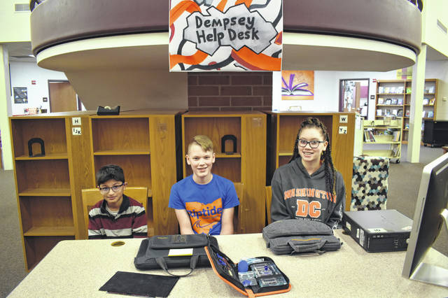 Pictured, left to right, working at the help desk at Dempsey Middle School are Manas Paranjape, Connor Frye and Eliah Curtis. The help desk has only been set up for about a month, but students have already replaced screens on Chromebooks and solved software issues for staff and students.