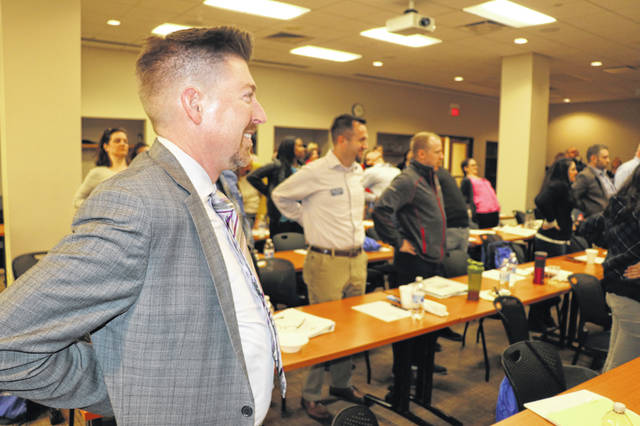 Jonathan Kelly, senior director of finance at Grady Memorial Hospital, performs a chair exercise during a Leadership Delaware County class held at OhioHealth Grady Memorial Hospital on Thursday. The nine-month leadership program is offered yearly by the Delaware Area Chamber of Commerce.