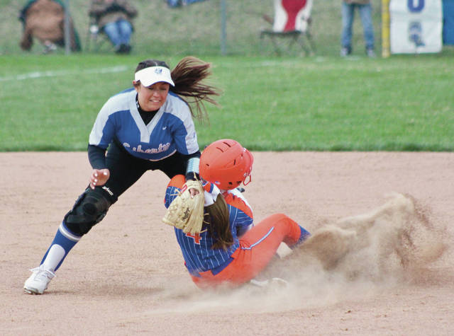 Olentangy Orange's Tatum Bardash slides under the tag of Olentangy Liberty's Sammy Leonhardt during Wednesday's game in Powell.