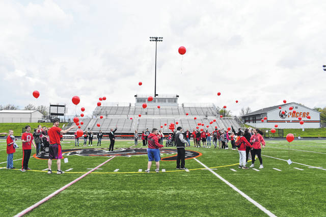 Students at Hayes High School who knew Evan Rothwell wore red and Star Wars shirts to school on Friday. To honor Rothwell, who passed away April 20, students released balloons Friday afternoon in Cornell Stadium.