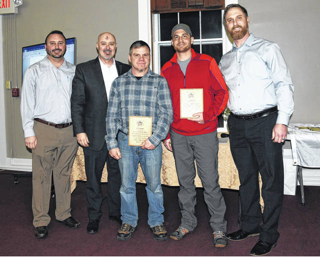 Pictured left to right, Sunbury Village councilmen Martin Fisher and Tim Gose; volunteers Joe Gochenour and Aaron Noblet; and councilman Joe St. John. Gochenour and Noblet were recognized for their landscape contributions to Sunbury.