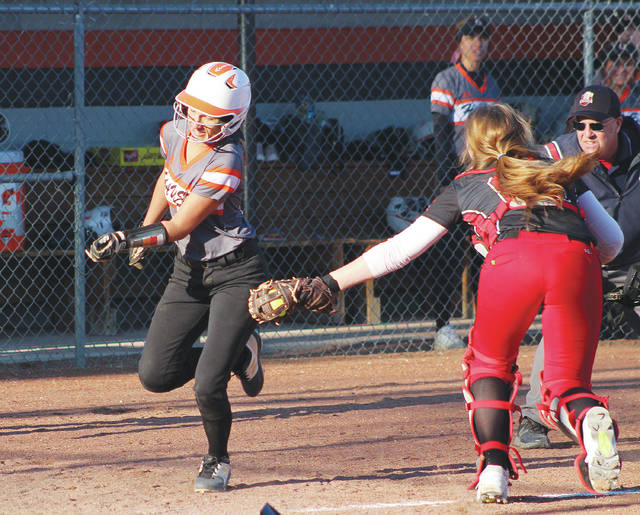 Hayes' Chloe Barton, left, tries to evade the tag by Groveport catcher Hannah Cline during Tuesday's non-league showdown in Delaware.