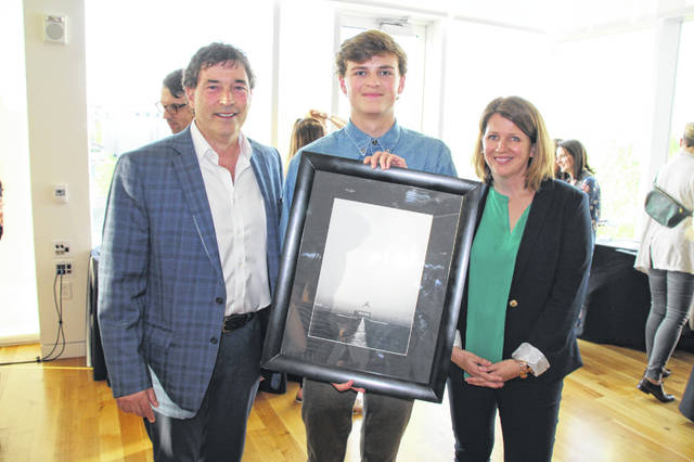 Congressman Troy Balderson, R-OH, poses with Matthew Brady, the 12th Congressional District winner of the 2019 Congressional Art Competition, and Beth Estelle, an aide responsible for helping coordinate this year's competition and reception. Brady is a junior at Olentangy Orange High School.