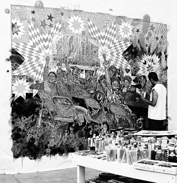 Artist Brett Cook, shown working in his studio, will meet with the community May 4 and 5 to continue planning for downtown Delaware murals.