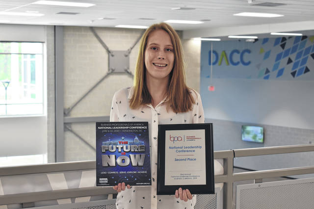 DACC senior Hannah Peterson poses with her second place award (right) and the design she completed for the National Leadership Conference (left). Peterson travelled to Anaheim, California, last week with several other DACC students and came home with second place in the graphic design competition.
