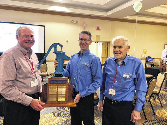 "Accepting the award for ""Best Tasting Water in Ohio"" are, left to right, Del-Co Board Director Timothy McNamara, General Manager and CEO Glenn Marzluf and Board Director William Cole."