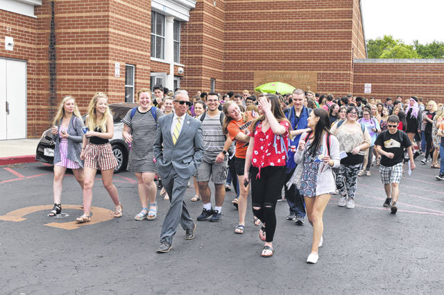 Delaware Hayes High School Principal Richard Stranges leads the Class of 2019 on a walk around the outside of Hayes Thursday afternoon after the class completed its last full day at school.