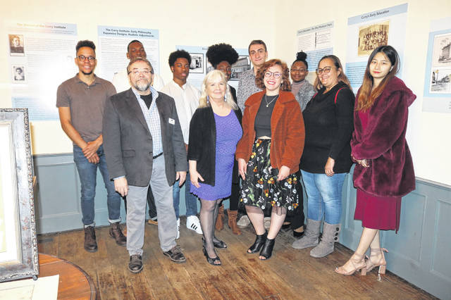 Pictured at the 2019 opening of the Meeker Homestead Museum are students in an Ohio Wesleyan University history class along with Delaware County Historical Society Curator Benny Shoults and OWU professors Barbara Terzian and Dawn Chisebe.