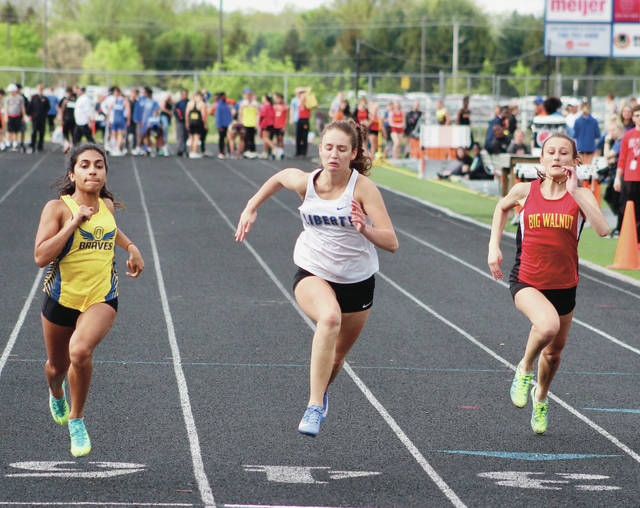 Olentangy's Muskan Arora, left, Liberty's Jessie Barna, center, and Big Walnut's Hanna Pinkston compete in the 100-meter dash during Friday's Delaware County Championships at Olentangy Orange. Arora, Barna and Pinkston finished first, second and third, respectively.