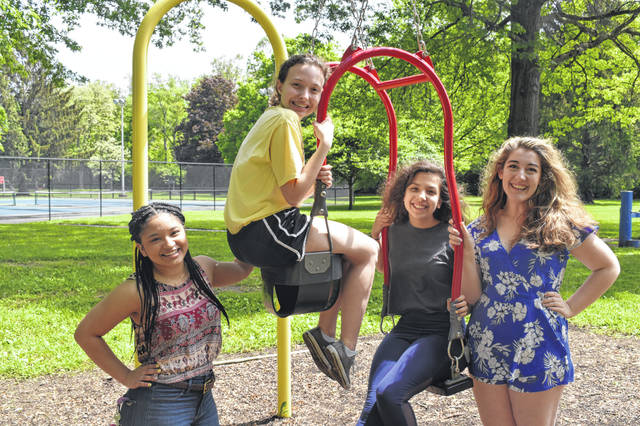 A group of seniors hang out on a swing set after lunch Thursday morning during the senior picnic. From left to right: Caroline Binkley, Madeline Thompson, Emily Mueller and Bella Bosco. The students said they were excited and looking forward to graduation.