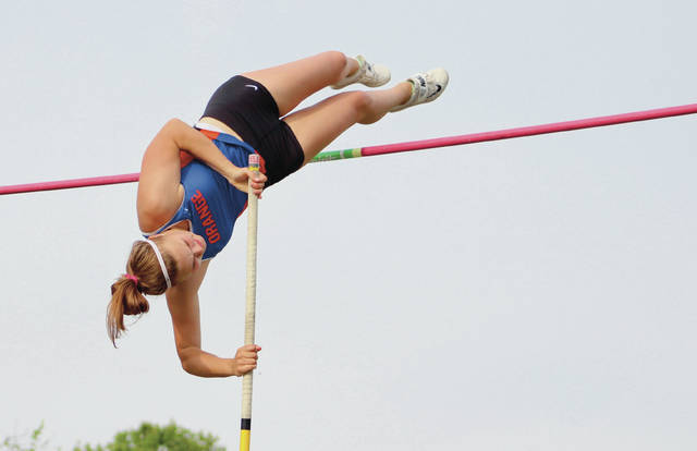 Olentangy Orange's Sara Borton competes in the pole vault at Friday's Division I regional championship meet in Pickerington.