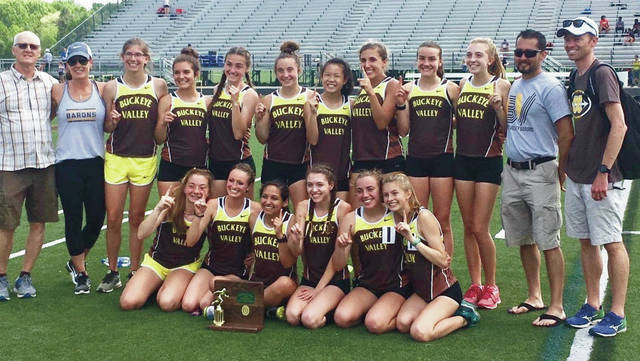 Members of the Buckeye Valley girls track and field team pose with their trophy after winning a Division II district title Saturday in Westerville.
