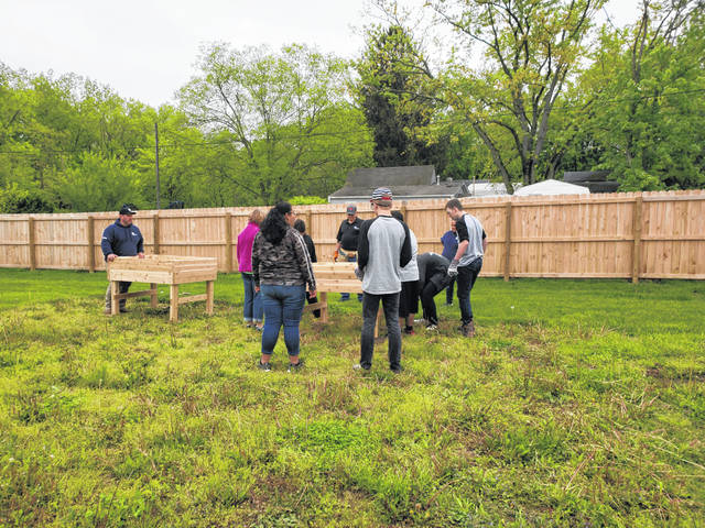 Big Walnut Middle School students, under adult supervision, build benches for the senior citizens of Rainbow Place in Sunbury on May 10.