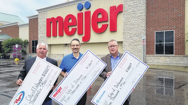 Pictured, left to right, in front of Meijer on Sunbury Road are Byers Auto Group Vice President John DuRivage, Delaware Meijer Store Director Rod Cline, and OhioHealth Dublin Methodist Hospital and OhioHealth Grady Memorial Hospital President Steve Bunyard.