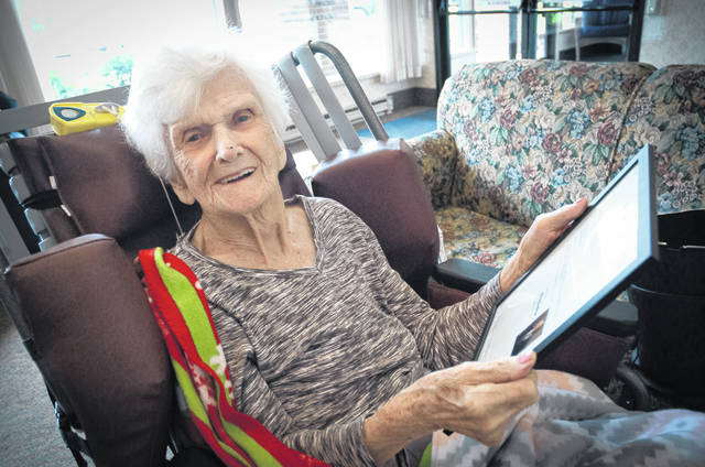 Iona Johnston, 102, looks at a proclamation she received earlier this week from U.S. Sen. Rob Portman (R-Ohio) and his wife, Jane, wishing her well and congratulating her on her 102nd birthday.
