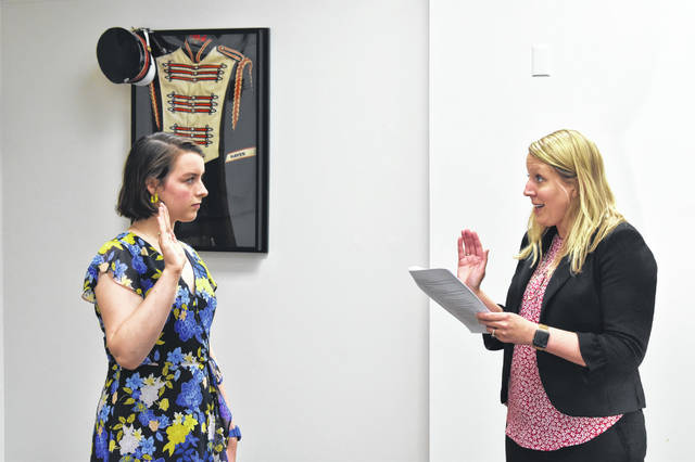 Student Board Member Mary Grace Duffy is sworn in by Delaware City Schools Treasurer Melissa N. Swearingen Monday night at the board's regular meeting. As the student board member, Duffy will attending meetings, update the board about Hayes High School and have a spiritual vote on all board actions.