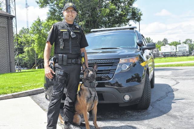 Delaware County Sheriff's Deputy Brandon Hunter and his partner, Kahless, pose outside the Delaware County Jail Thursday. Hunter and Kahless have been working together for three weeks and have already located suspects and narcotics.