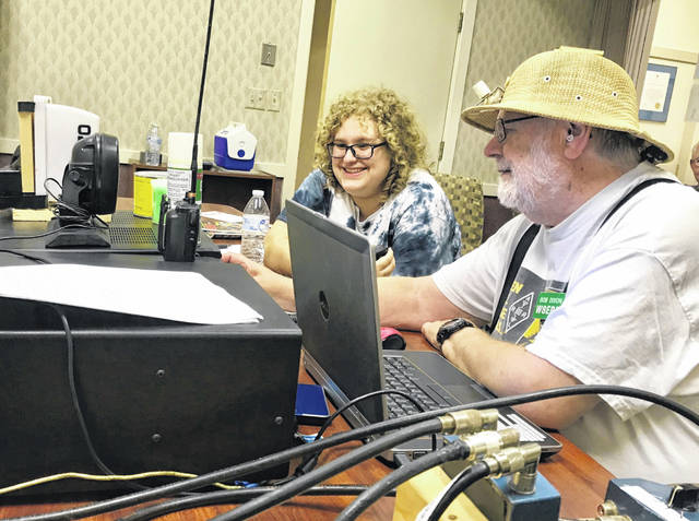 Delaware Amateur Radio Association operates a station to allow non-licensed beginners a chance to try out ham radio. Jillian Brodsky, right, made her first contacts by using the station during last year's Field Day under the guidance of Dr. Bob Dixon, Ostrander.
