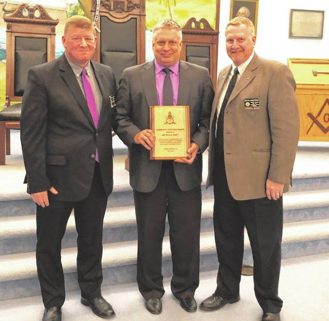 Pictured, left to right, are Gary Hayward (Hiram Lodge), Paul Kraft (honoree) and Eric Longstreth (worshipful master of Hiram Lodge).