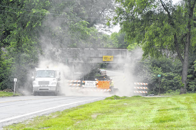 U.S. Route 42 in Delaware is closed at Shortcut Road for waterline work. Pictured is a crew at work on Tuesday morning. The road is expected to reopen on Friday.