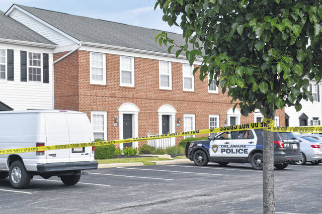 A City of Delaware Police Department cruiser sits in a taped-off section of the parking lot outside an apartment at Troy Farms on Saddlebrook Court Wednesday morning. Police received a report of an altercation that left two individuals with knife wounds around 2:45 a.m. and investigated the incident throughout the day Wednesday. An investigation is still ongoing.