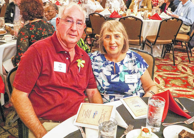 SourcePoint volunteer Jim Smith, left, celebrates 10 years of service at the nonprofit's annual volunteer appreciation dinner with fellow volunteer Judy Rosumenko.
