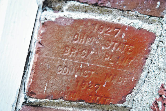 "Just outside the back entrance of the oldest part of Wornstaff Memorial Public Library is a couple of bricks inscribed, ""Ohio State Brick Plant 1927 convict made."" The original bricks of the old library building along with the furniture was manufactured by the inmates at the Mansfield Reformatory."