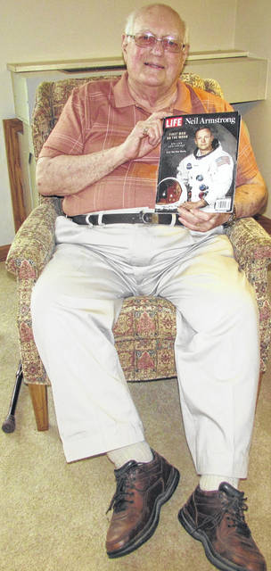 Dudley Schuler, a childhood friend of Neil Armstrong's, holds a Life Magazine with Armstrong on the cover that the collected.