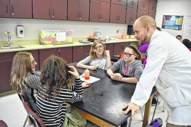Middle School Educator of the Year award winner Jonathon Kelley speaks to sixth-grade students during a hands-on lab to create lava lamps in December 2018. Kelley was given the award and praised for providing students with hands-on activities and personalized education.