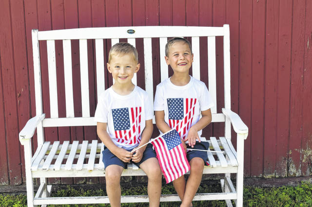 Austin Stromski and Jaxon Williamson sit together Friday, days before they will take part in the Fourth of July Parade to raise awareness for Childhood Apraxia of Speech, a disorder they both have. Apraxia affects the way children produce speech and makes it difficult for them to pronounce the right syllables. The boys will be in the parade to raise awareness of the disorder and to promote the upcoming 2019 Columbus Walk for Apraxia, a charity drive being held on Sept. 15 in Dublin. The pair have already raised more than $2,300 for the event.