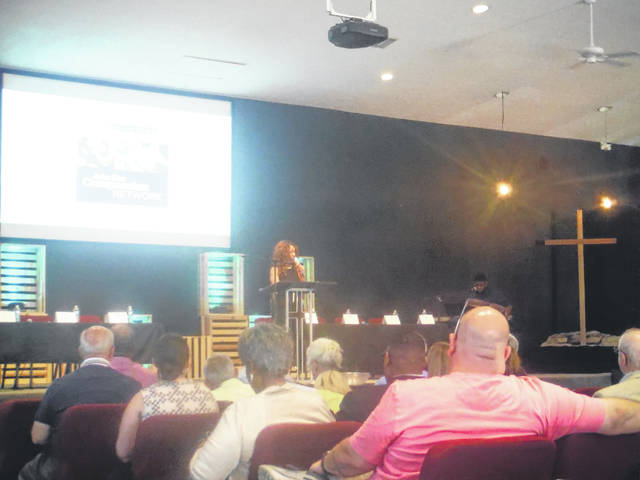 Michele Reynolds, director of the Governor's Office of Faith-Based and Community Initiatives, speaks to an audience at Northgate Church in Sunbury.