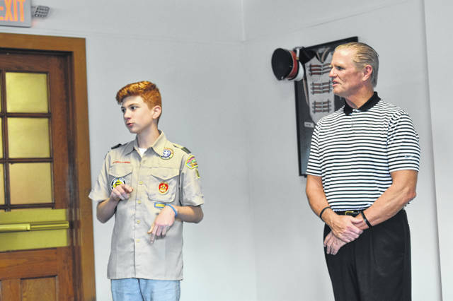 Eighth grader Calvin Riggs speaks to the Delaware City Schools Board of Education Monday, along with Athletic Director Steve Glesenkamp, who helped him put his Eagle Scout project together.