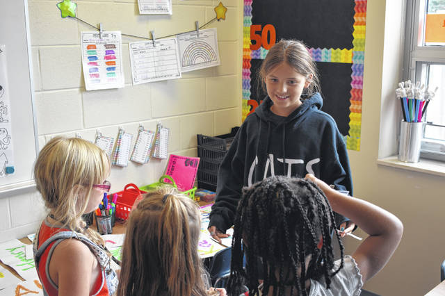 Kylie Simpson, a fifth grade team leader, asks the kindergartners on her team how their school year is going so far. Conger divides its student population into seven teams in order to building communities, help students form long lasting relationships, and give students leadership opportunities.