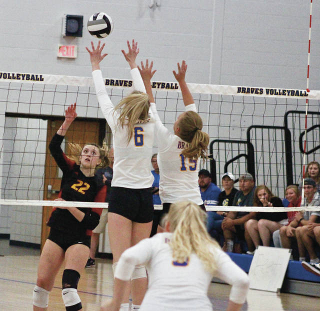 Big Walnut's Caroline Speelman (22) lofts a shot over Olentangy's Maddie Harris (6) and Taylor Lansford (15) during Tuesday's non-league showdown in Lewis Center.