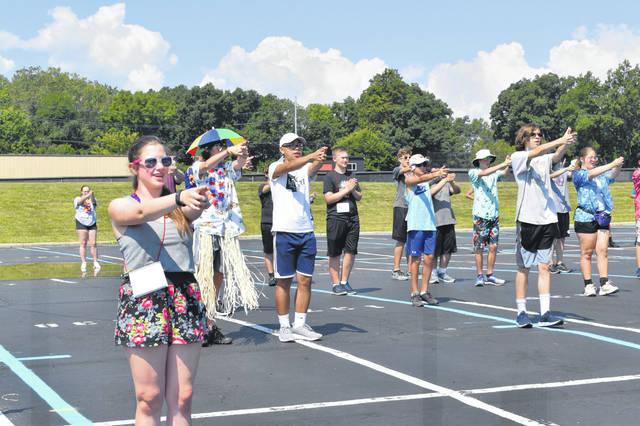 Members of the Delaware Hayes High School Marching Band dressed in tropical attire Monday for the first theme day of band camp, Beach Day. The band practiced 9 a.m. to 9 p.m. Monday and will practice for the rest of the week to learn the music and drill for its upcoming season.