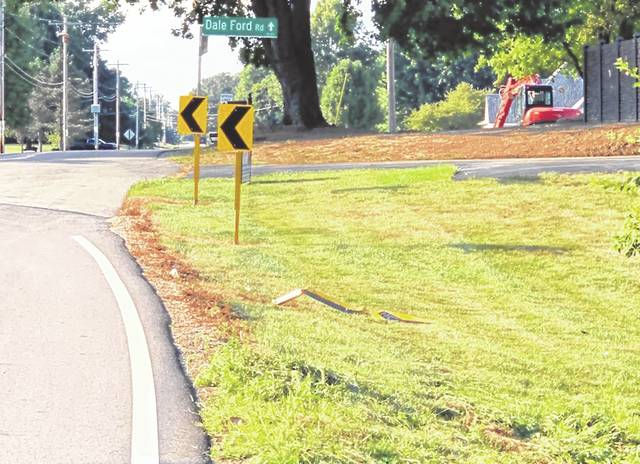 Signs marking the curve on Berlin Station Road near Dale Ford Road lay in the grass after being knocked over by drivers taking the turn too fast.