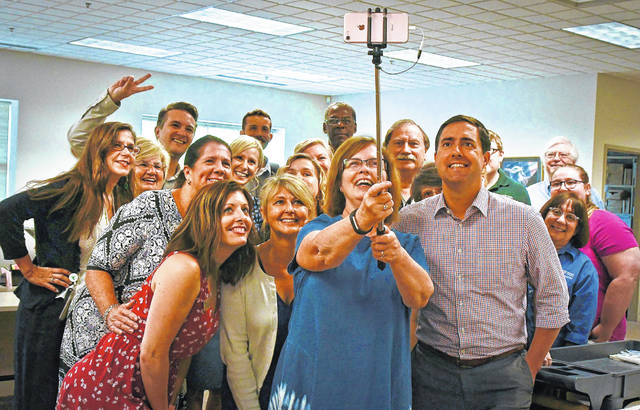 Ohio Secretary of State Frank LaRose, front right, toured the Delaware County Board of Elections Tuesday morning. Before he left, Brenda Manly, a BOE staff member, pulled out a selfie stick and insisted on getting a photo of the staff with LaRose.