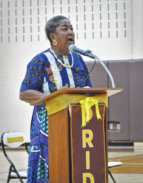 Christine Tollberts Norman, co-founder of Educational Advancement Programs (REACH), spoke to students at Buckeye Middle School in three separate sessions Thursday about her experiences and her home country of Liberia.