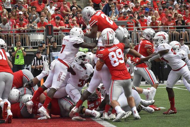 Ohio State running back J.K. Dobbins leaps into the end zone for a fourth-quarter touchdown.