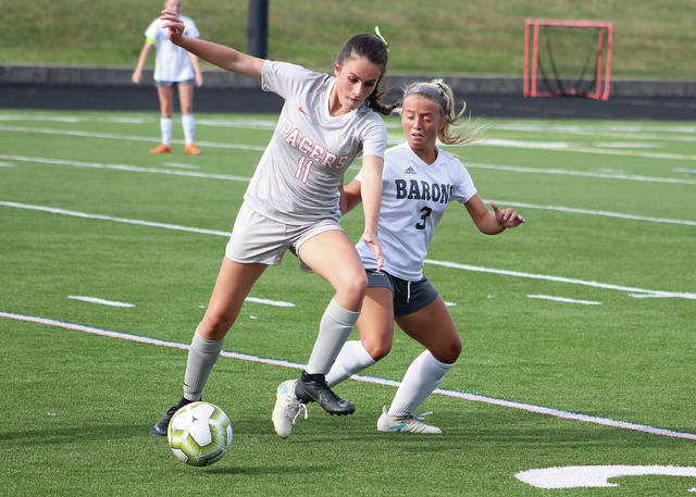 Hayes' Aubrey Griner (11) and Buckeye Valley's Faith Durbin (3) battle for possession during the second half of Friday's opener in Delaware.