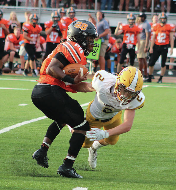 Hayes' Jahi Broussard-Nash eludes Buckeye Valley's Jake Smothers (2) during the first half of Friday's season opener in Delaware.