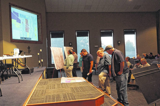 Berlin Township residents look over the latest drawings for the Berlin Business Park at a special hearing Wednesday. Due to the turnout, the meeting was held at Grace Point Community Church.
