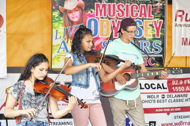Delaware native bluegrass group, SoundPost, performs its first show Sunday afternoon on the WDLR stage at the Delaware County Fair. The group consists of six members. Pictured, left to right, are Isabelle Baldwin, Ava Wachtman and Benji Wachtman.